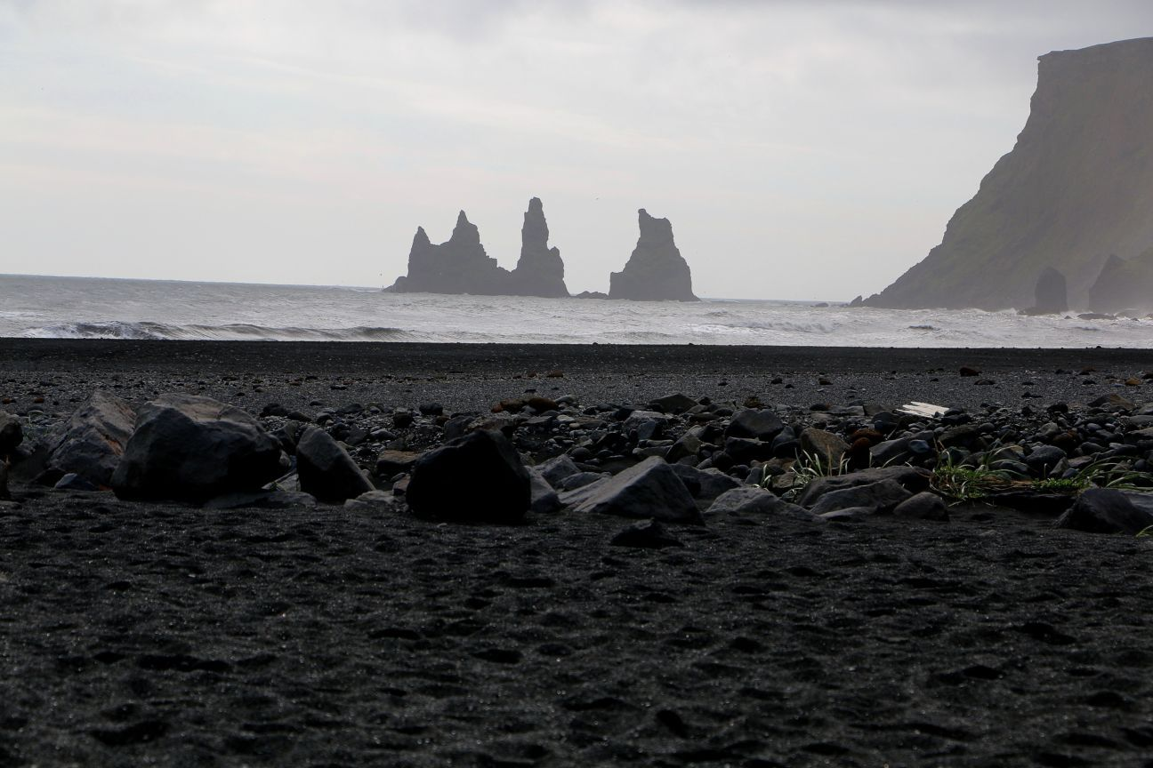 Black sand beach troll ship iceland
